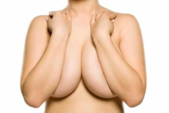 woman-large-breasted-arms-covering